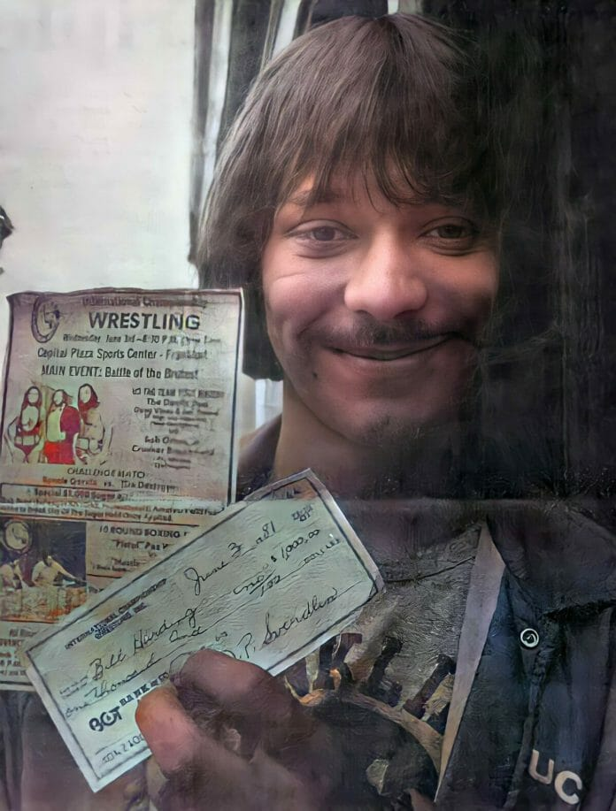William Harding proudly shows off his Sugar Hold Challenge winnings: a check of $1000.