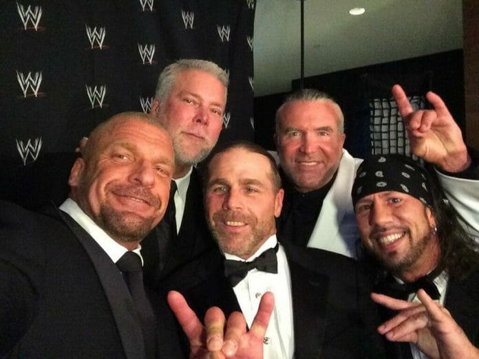 The Kliq (Triple H, Kevin Nash, Shawn Michaels, Scott Hall, and Shawn Waltman) pose for a selfie at the 2014 WWE Hall of Fame ceremony.