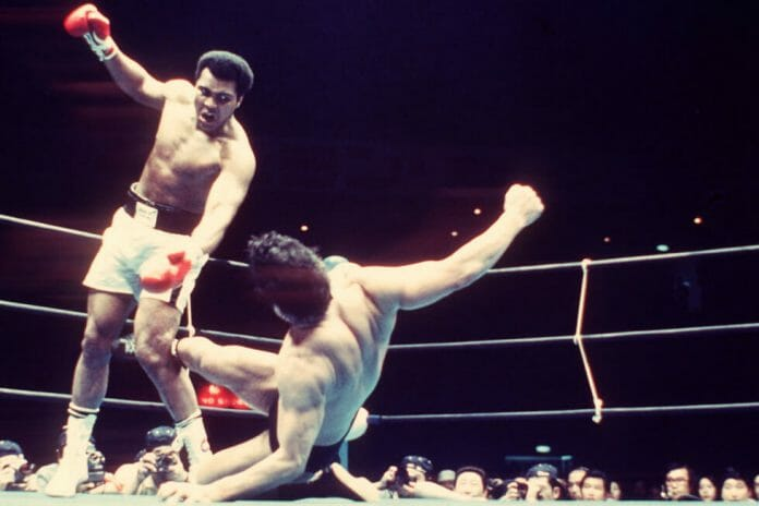 Antonio Inoki sends kicks in the direction of Muhammad Ali from the ground during their boxer vs. wrestler bout that took place on June 26, 1976, at the Nippon Budokan, Tokyo, Japan.