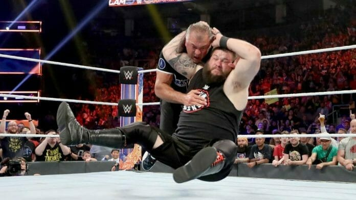 Kevin Owens hits the Stunner on Shane McMahon.