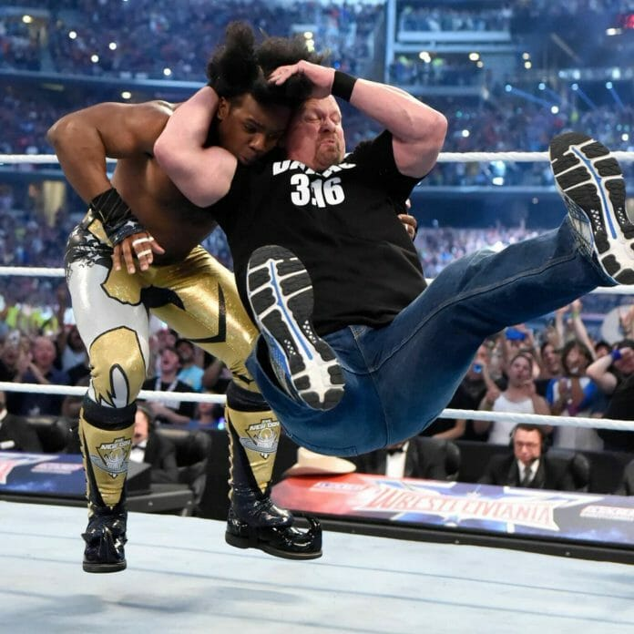 Xavier Woods receives the Stunner courtesy of Stone Cold Steve Austin at WrestleMania 32.