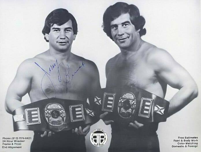 Jerry and Jack Brisco of The Brisco Brothers with the Georgia Tag Team Championships.