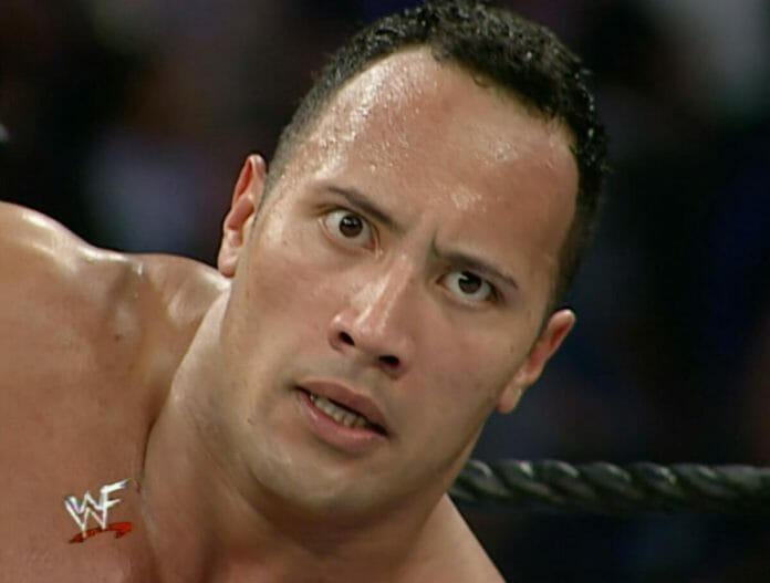 The Rock locks eyes with Stone Cold Steve Austin for the first time at the 2001 Royal Rumble.