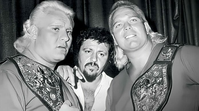 """WWWF Tag Team Champions """"The Valiant Brothers"""" (Johnny and Jimmy Valiant) alongside manager Lou Albano in 1974."""